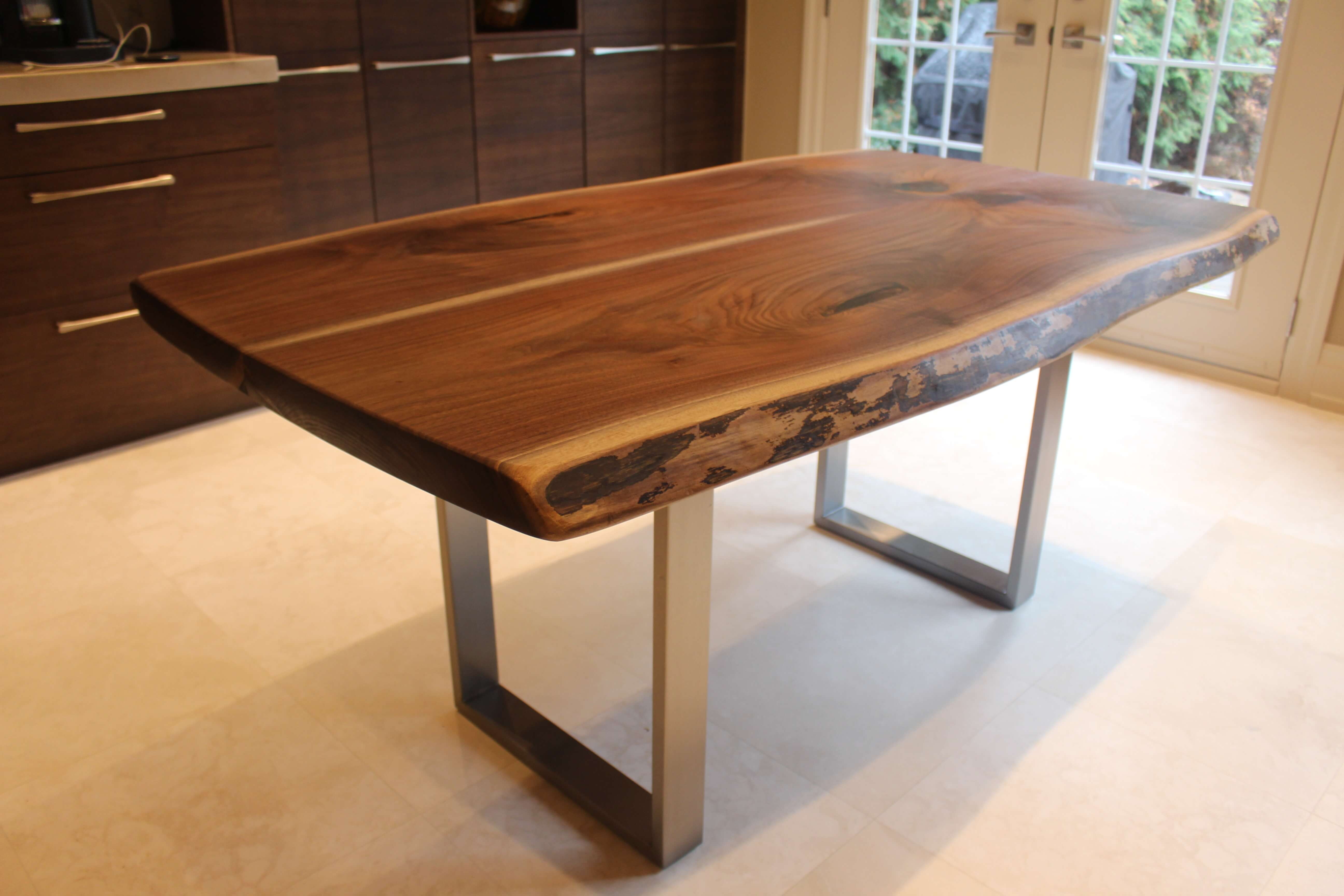 live edge black walnut table with stainless steel base Living & Muskoka Ontario Canada