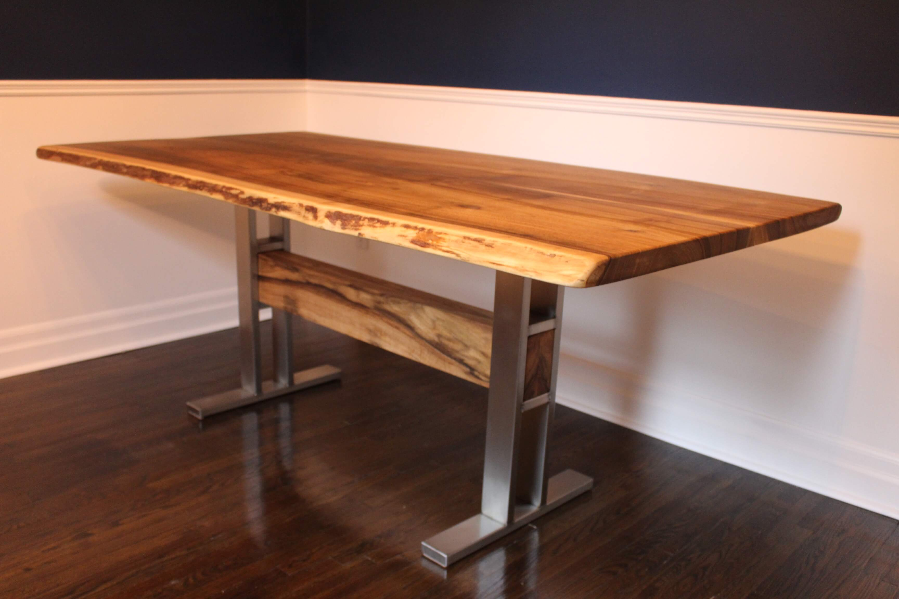 live edge walnut table with stainless steel trestle base with wood beam, made in muskoka, ships to NYC and toronto